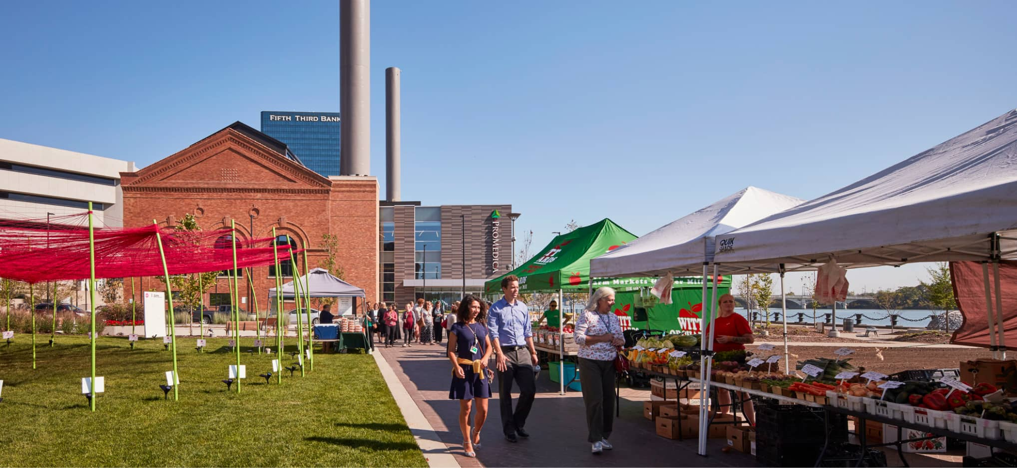 With wide promenades and green spaces suitable for a variety of uses from farmer's markets to festivals, ProMedica Headquarters in Toledo, Ohio, takes advantage of new and historic buildings, and all the spaces in between.